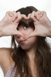 Heart. The girl looks through hands symbolizing heart Royalty Free Stock Images