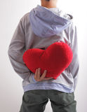 Heart. The young man tried to steal the heart of the girl he loves Stock Photography