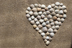 Heart. Made up of shells on sand Royalty Free Stock Photo