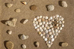 Heart. Made up of shells on sand Royalty Free Stock Photography