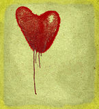 Heart. Bleeding heart on paper background with space for text Stock Image