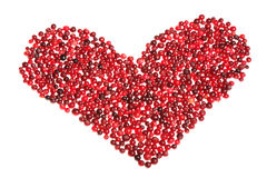 Heart. Red heart of ripe cranberries on white background Royalty Free Stock Photography