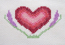 Heart. Embroidered on a fabric cross stitch Royalty Free Stock Photography