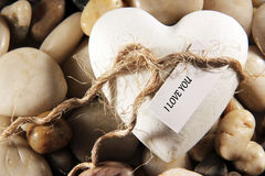 Heart. A white heart with the text I love you on pebbles Stock Photo