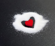 Heart. Red heart from sugar grains royalty free stock photo