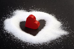 Heart. Sugar grains and red heart stock image