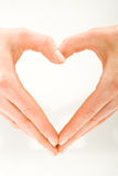 Heart. The form of heart shaped by female hands on a white background Royalty Free Stock Image