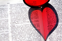 Heart. Close-up of dictionary definition of love with a filter producing shape of heart stock image