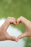 Heart. A woman and man put their hands together to make a heart shape Stock Photos