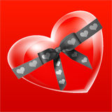 Heart-in. A red heart bound with black ribbon Royalty Free Stock Photos