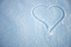 Heart. Silhouette, drawn in the snow Stock Photography