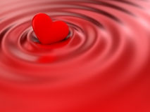 Heart. Floating on red silk Royalty Free Stock Photography
