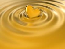 Heart. Floating on golden silk Stock Image