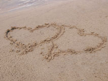 Heart. Figure of two hearts on sand of a beach Stock Photos