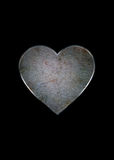 Heart. Metal rusty heart on a black background Stock Photos