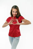 Heart. The woman on a white background in a red blouse represents heart Royalty Free Stock Photos