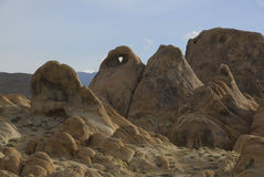 Heart of the Alabama Hills. Heart shaped hole in boulder in the Alabama Hills below Mt. Whitney in California Stock Photo