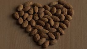 Heart of almonds. Old wrinkled almond depicts heart stock footage