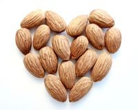 Heart of almonds on white background Stock Photography