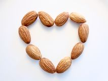 Heart of almonds on white background Stock Image
