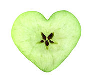 Heart apple slice. Green apple cross section shaped like heart on white background Royalty Free Stock Photography