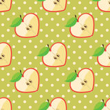 Heart of apples in seamless pattern on polka dot b. Apple halves heart shaped and polka dot on the black background.Сartoon  Оrnament.Vector seamless pattern Stock Photos