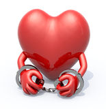 Heart with arms and handcuffs on hands Stock Photo