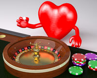 Heart with arms and legs behind roulette table in a casino Stock Photos