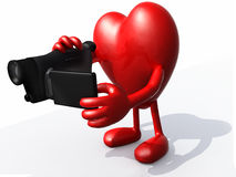 Heart with arms, legs and digital video camera Stock Image