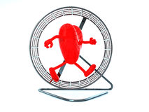 Heart with arms and legs in hamster wheel Stock Photo