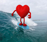 Heart with arms and legs surfing on the sea Royalty Free Stock Photography