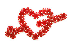Heart and arrow. Made of poker chips isolated over white Stock Image