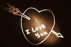 Heart with an arrow stock photography