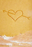 Heart with arrow in dough Royalty Free Stock Images