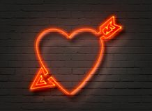 Heart With Arrow, neon sign on brick wall. Background. 3D illustration Stock Photos