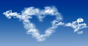 Heart and arrow out of the clouds on blue sky. Stock Photography