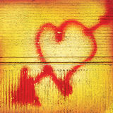 Heart with an arrow painted in red on a background of old concre. Te wall Royalty Free Stock Photos
