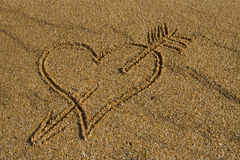 Heart with arrow in the sand. Royalty Free Stock Photo