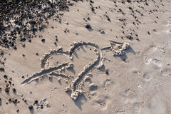Heart with Arrow in the sand Royalty Free Stock Photography