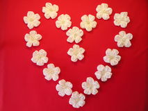Heart from artificial flowers Royalty Free Stock Photos