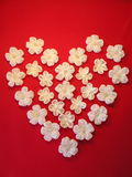 Heart from artificial flowers Stock Photography