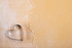 Heart as cutter with dough Royalty Free Stock Image