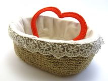 Heart as a gift. Red heart made of yarn in basket on white background royalty free stock images