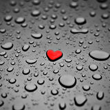 Heart as a rain drop. Red heart as a rain drop on the grey background Stock Photography