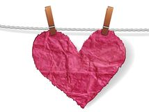 Heart attached to a clothesline with pin Stock Photo