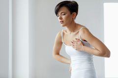 Heart Attack. Beautiful Woman Feeling Pain In Chest. Health Care Stock Images