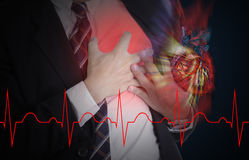 Heart Attack concept by use hand grabbing a chest royalty free stock photography