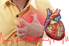 Heart Attack concept by use hand grabbing a chest Royalty Free Stock Photos