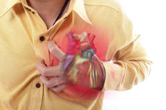 Heart Attack concept by use hand grabbing a chest. Heart Attack concept by using hand grabbing a chest with heart graphic and white background Stock Image