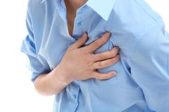 Heart attack concept. Young woman suffering from chest. Pain on white background Royalty Free Stock Photos